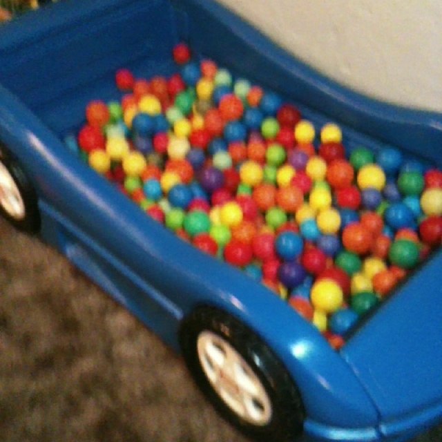 Toddler race car bed used as ball pit!! Well since I can't