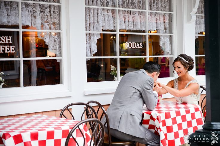 Bride and groom portrait - Ice cream shop - table - Vancouver Wedding Photographers - http://www.butterstudios.ca | Burnaby Village Museum
