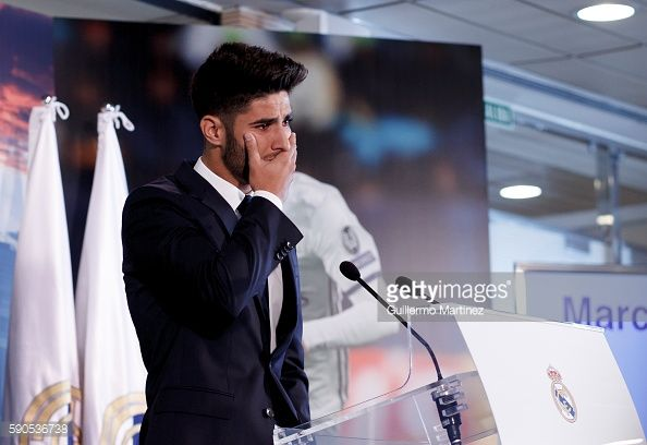 News Photo : Marco Asensio cries during his presentation as...