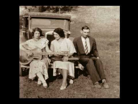 The Carter Family - The Church In The WildWood.  Growing up in WV, this is one of the first songs i remember singing in church.