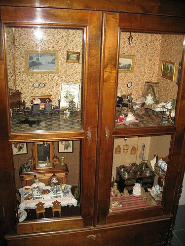 Beautiful and a great idea to keep out dust.cabinet to antique miniatures dollhouse