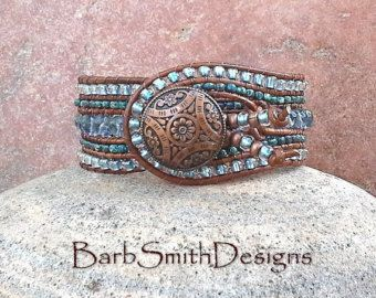 The Indian Princess (The Chunky One)  The center row of this chunky cuff bracelet features a Josephine Knot, followed by a row of Aqua opaque table cut glass beads. The two outer rows are stitched in Turquoise Opaque Picasso and silver Toho seed beads. The Chunky One is adorned with a beautiful hammered silver flower button, two silver beaded feathers and is stitched on a brown distressed Indian leather cord.  Measure your wrist! This bracelet fits a size 6 1/4 wrist.  If you would love to…