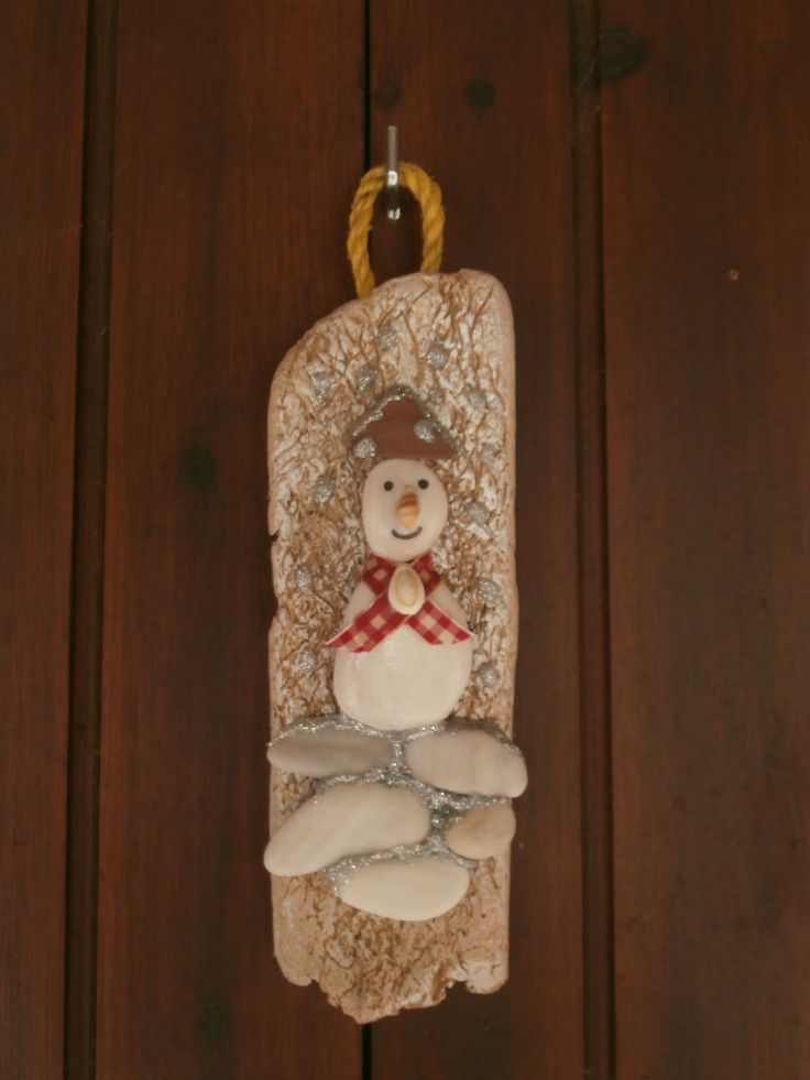 Pebble snowman on driftwood base, wall hanging decoration