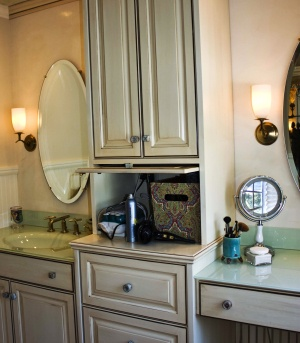 """Master bathroom-- use of """"appliance garage"""" to hide bathroom clutter like hair dryer, electric toothbrush, etc.  Install electrical outlets inside so these bathroom appliances stay plugged in and easy to reach."""