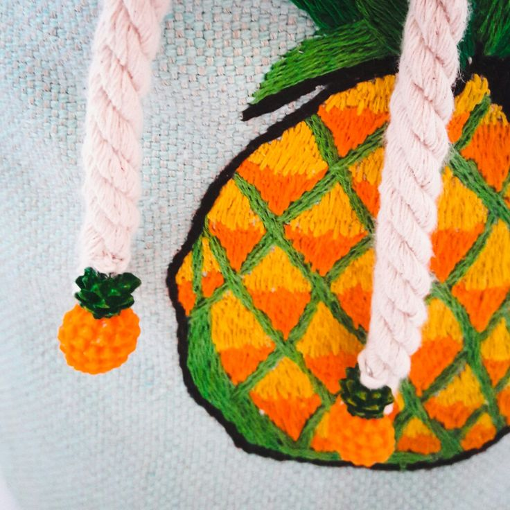 Embroidered pineapple on a bucket bag
