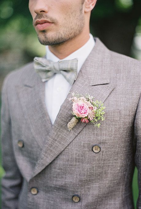 Brides.com: . A mini pink garden rose boutonniere with greenery created by L'Art Qui Pousse.