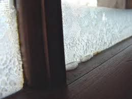 I remember ice on the inside of the windows in cold winters