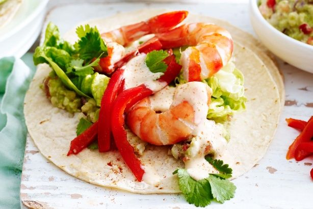 For a lighter alternative to Mexican cuisine try these zesty prawn tacos topped with fresh guacamole, smoky mayonnaise and coriander.