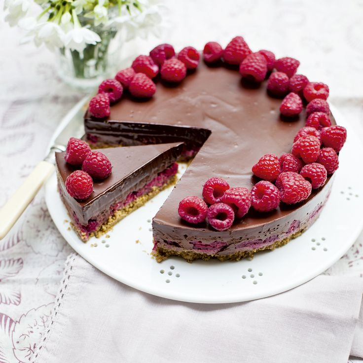A creamy chocolate filling sits on tart raspberries over a crumbly biscuit base in this delicious dessert recipe