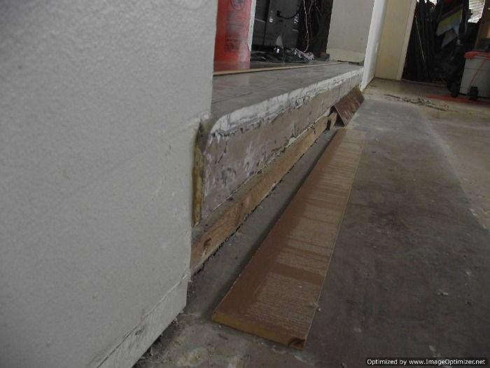 Sunken Living Room Concrete Step Down To Have Laminate Flooring Installed On The Concrete Sunken Living