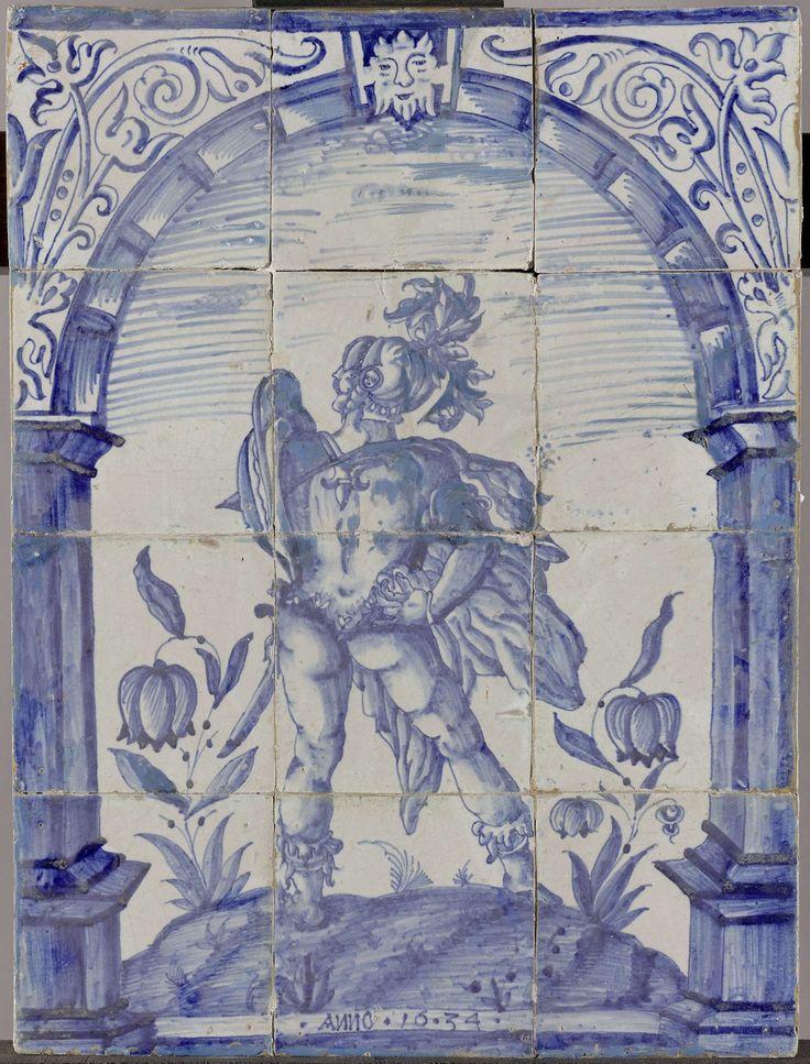 Anonymous   Tegeltableau met Marcus Valerius Corvus, Anonymous, Hendrick Goltzius, 1634   Tegeltableau van twaalf blauw geschilderde tegels (4 x 3) met de Romeinse held Marcus Valerius Corvus in harnas op de rug gezien, staande op een grondje tussen planten. Hij staat onder een boog met als sluitsteen een masker en in de zwikken bloemranken. Onderaan het opschrift: .ANNO. 16.34.