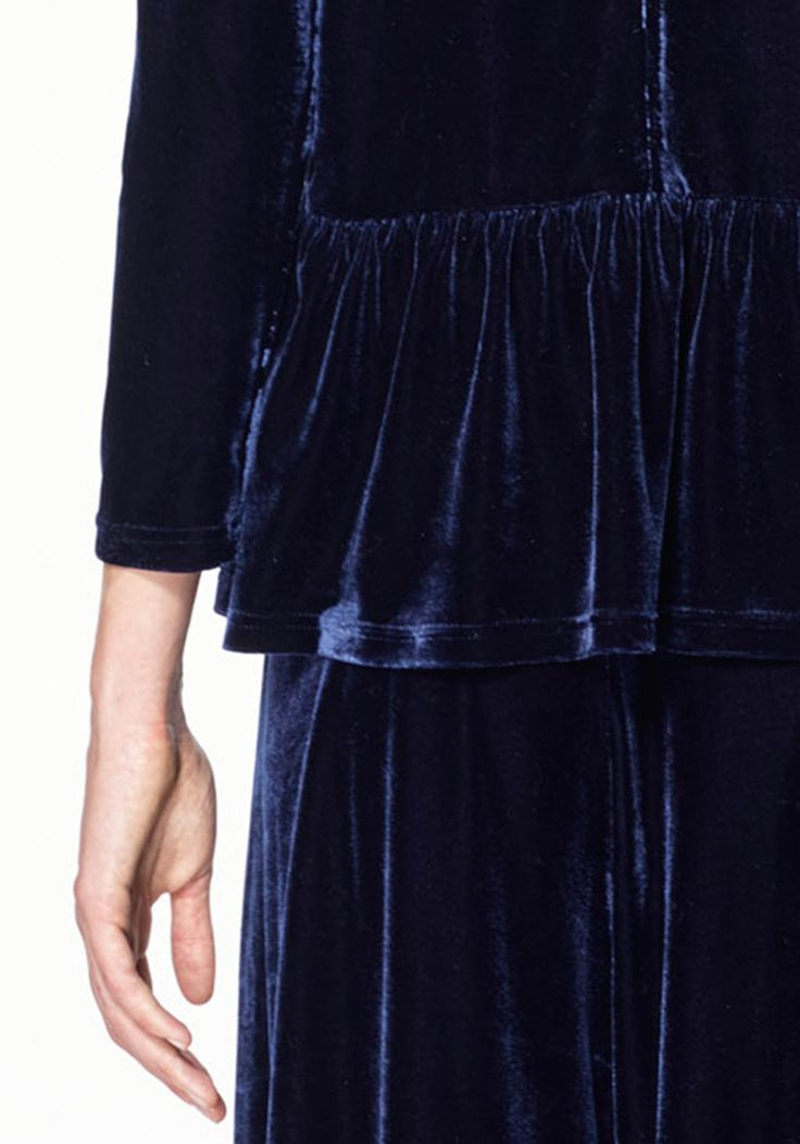 """Embrace a modern Victorian look this season with a sumptuous velvet top, this top features a flattering peplum around the waist and a turtleneck. Wear with peg leg trousers and heels for a fierce finish.  Also available in plum.  Our model wears a UK 8 and 180 cm / 5' 11"""" tall"""