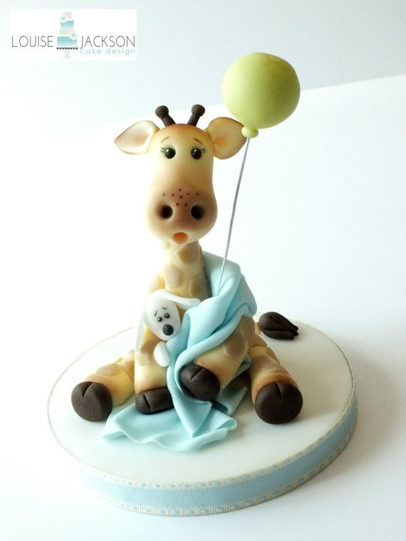 Adorable baby giraffe cake topper TUTORIAL in .pdf Learn how to make this topper with detailed easy to follow instructions with 64 coloured pictures taking you through every step. This topper is perfect for christening cakes as shown in the picture or any little girl or boys birthday celebration cake. When made, the giraffe is 5 tall and sits on a 5 round board so ideal for any celebration cake of 6 or more. The example shown is an 8 cake. On purchasing this item you will be able to…