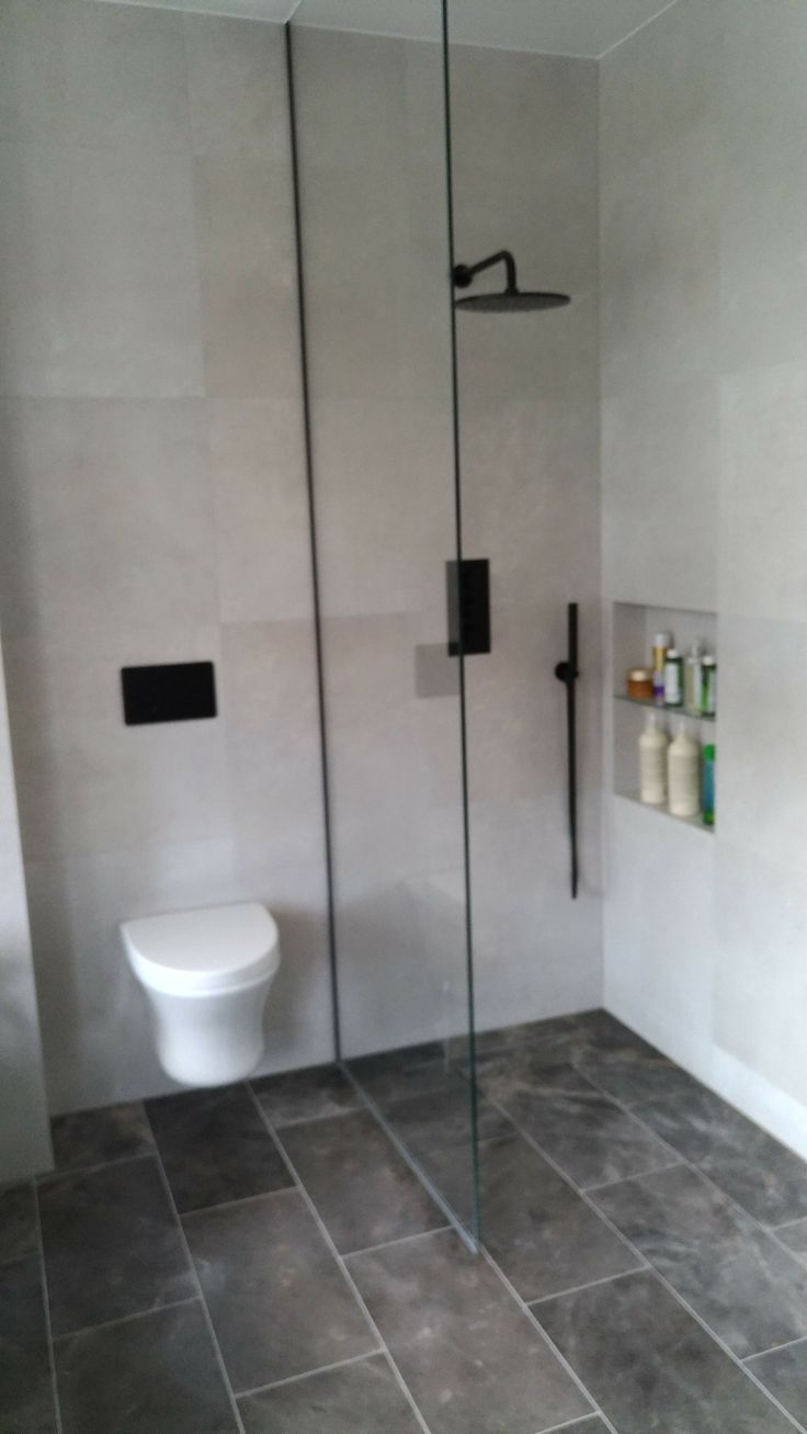 Walk in shower with black fittings by Sharp Projects