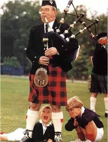 Bagpipes and bad sights, United Kingdom, c.1985, photographer unknown.