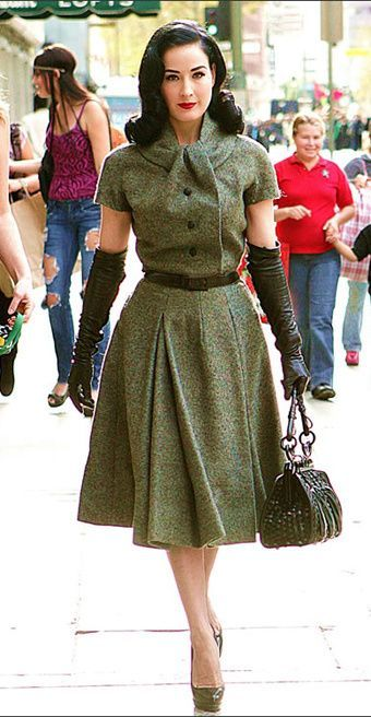 Dita Von Teese In A Military Inspired Swing Dress With Opera Gloves