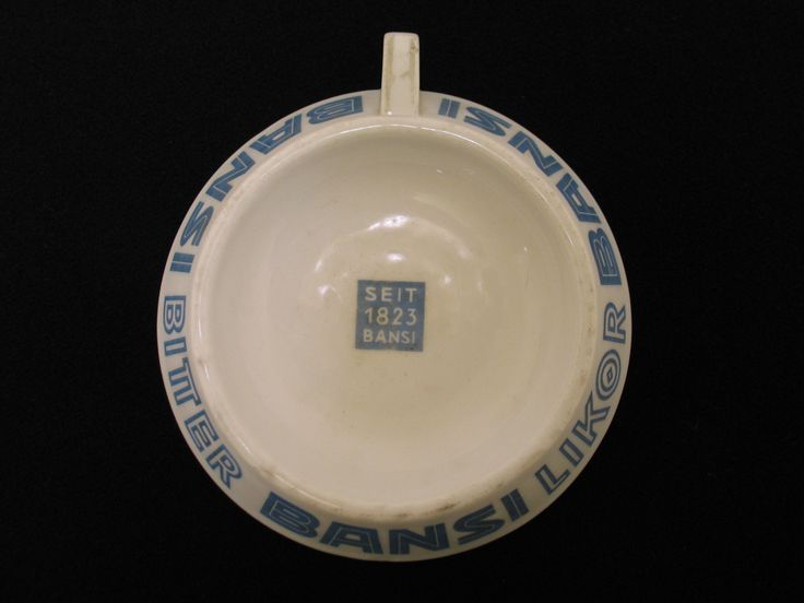Porcelain ashtray souvenired by Flight Lieutenant Campbell McClean when returning from Germany when he had been a prisoner of war during World War Two. From the collection of the Air Force Museum of New Zealand.