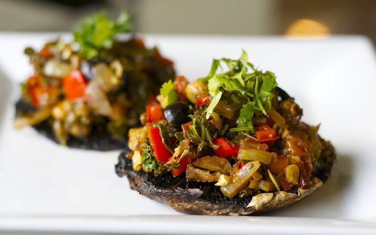 In this recipe, portobello mushrooms caps are piled high with herbed ...