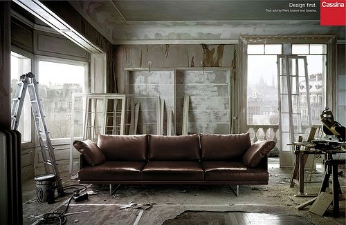 The unfinished grey room only adds to the elegant walnut sofa. Cassina/Piero Lissoni Toot sofa: Elle Decoration