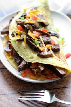 An IHOP copycat recipe for Big Steak Omelette: a giant omelette stuffed to the brim with steak, bell peppers, onions, cheese, hash browns and mushrooms!