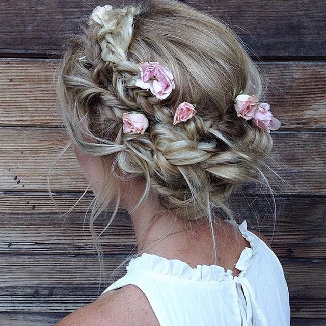 The perfect boho updo with flowers  What's your fave hair accessory?   Hair by @heidimariegarrett on @emmmbo