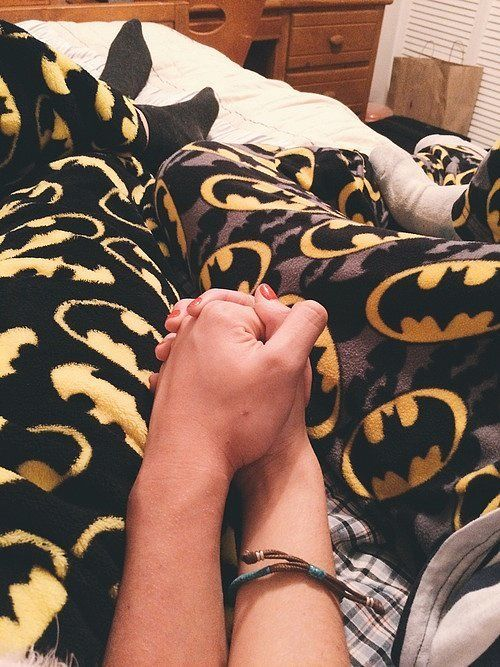 Geek Relationship Goals So Cute, You'll Cringe: Matching superhero pajamas.