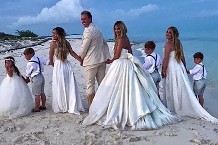 Kim Zolciak and husband Kroy Biermann renewed their vows to one another in a beautiful beach ceremony over Mother's Day weekend.....