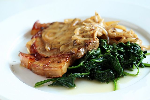 Pork chops with cider cream sauce and spinach