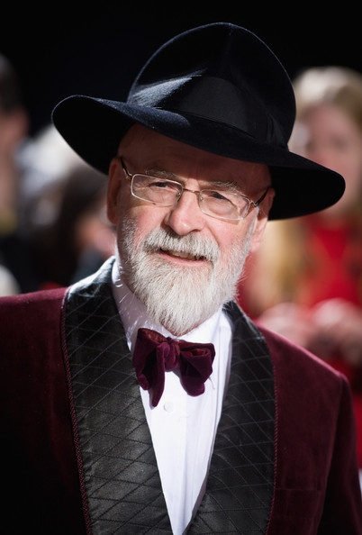 Sir Terry Pratchett - I am reading and love the Tiffany Aching books by him.
