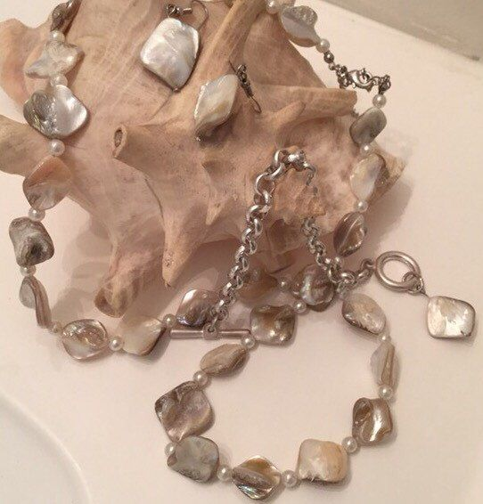 A personal favorite from my Etsy shop https://www.etsy.com/ca/listing/233542331/shell-necklace-earring-and-bracelet-set