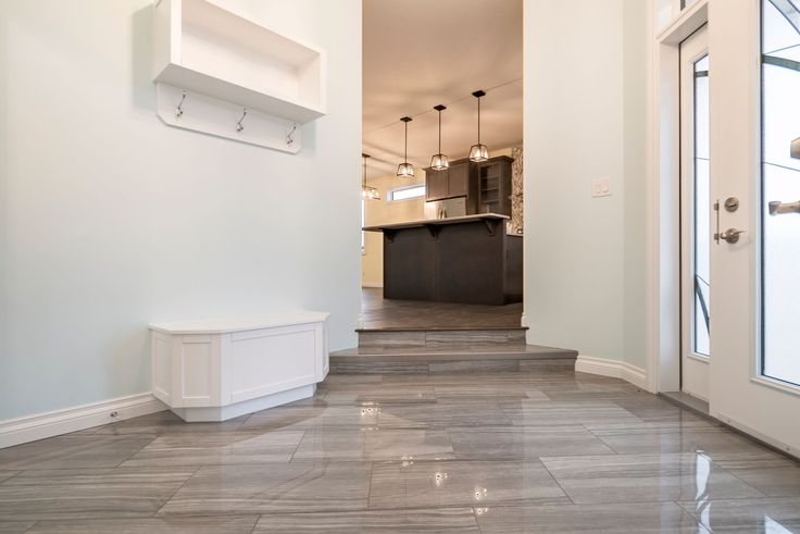 Open front entry with beautiful tile flooring #spaciousliving #openandbright