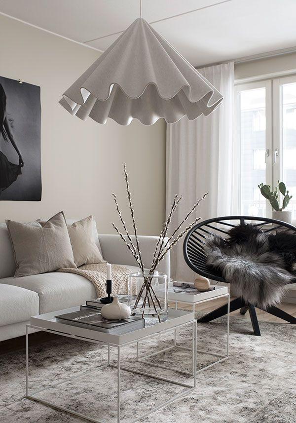 Modern Scandinavian living room in light beige tones.