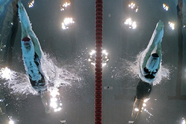 (L-R) Gemma Lowe of Great Britain and Kathleen Hersey of the United States dive in the water at the start of the Women's 200m Butterfly semi final 2 on Day 4 of the London 2012 Olympic Games at the Aquatics Centre on July 31, 2012 in London, England