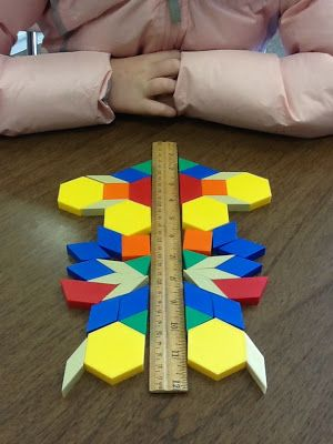 Learning symmetry with pattern blocks.. bring from home. add to pattern center.