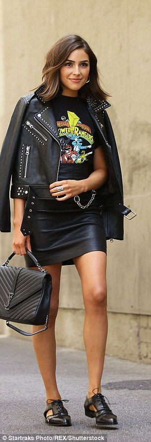 Ready to rock: The 24-year-old wore the superhero t-shirt with a leather skirt and studded leather jacket