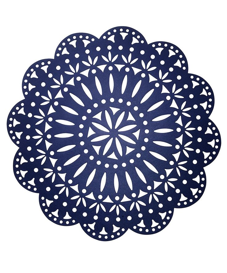 Fete Placemat - White and Navy - Festive outlines in tried-and-true colors create an essential dining basic that's impossible to overlook. Somewhere between floral and nautical, between lacy vintage and laser-cut modernity, the transitional Fete Placemat in White and Navy is a reversible round placemat with the power to make a high-impact visual statement on dining tables of any style.