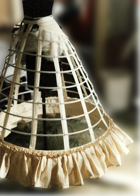 Cage crinoline made with tape and steel - with a interesting ruffle around the bottom, 1862.