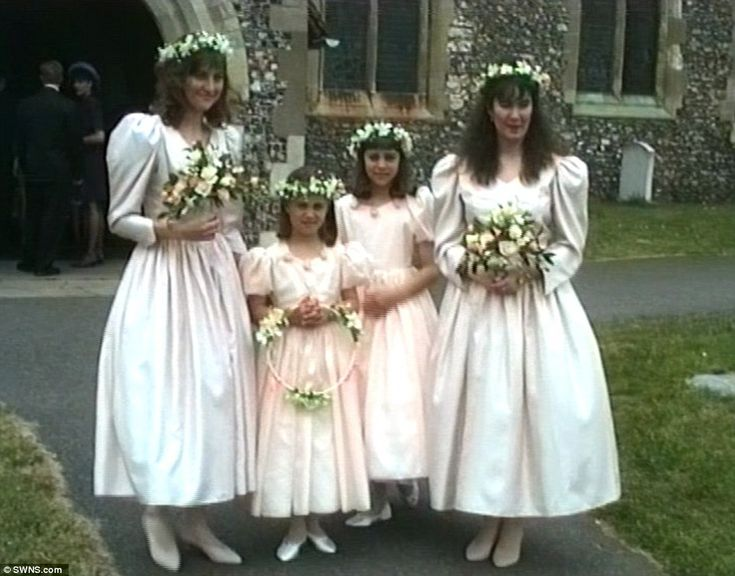 The girls, dressed in matching pink dresses, joined two older bridesmaids at the ceremony