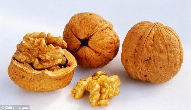Walnuts, pictured, are rich in alpha-linolenic acid, the plant-based omega-3 fatty acid, w...