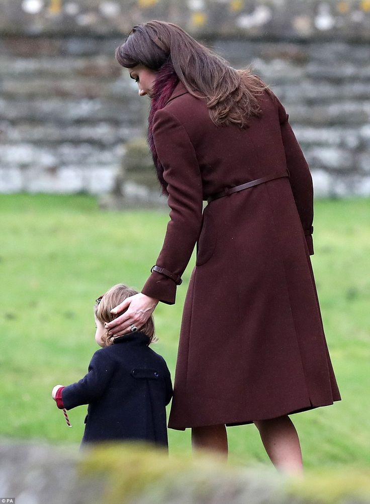 The Duchess of Cambridge lovingly guided Princess Charlotte as the tot walked out of the church service