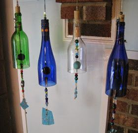 Thought I'd do a short post to show you what I've been making lately. Wine bottle wind chimes. I make them from recycled win...