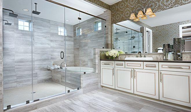 This lavish bathroom in Aldie, VA, features an expansive walk-in shower | Harmon plan by Richmond American