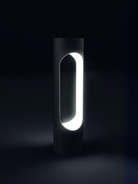 BOLLARD  Illuminated bollard with elongated hole which inner surface contains multiple LED lights. The variable control of the light offers a diversity of appearance and applications for the cityscape.