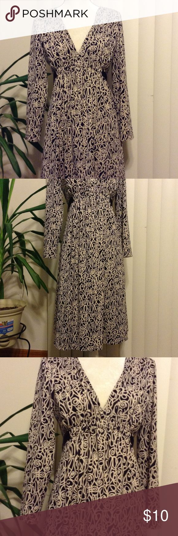 Women's empire waist dress Beautifully patterned cream and white long sleeve empire style dressed. Elastic at waist. Satin like attached black tie that falls to the back of dress. Polyester/Spandex blend. Size Large Lapis Dresses Long Sleeve