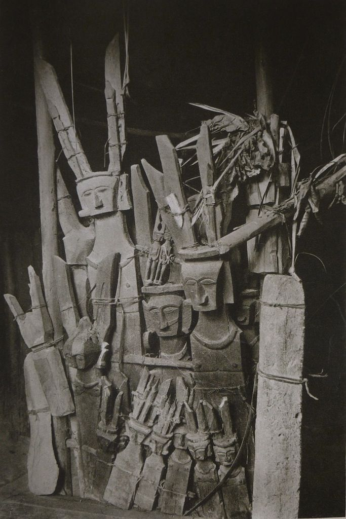 Dr Paul Wirz (1892-1955)    Idols of wood and stone in a House of Nias    From his Book: 'Nias, Die Insel der Götzen'. Ed. Orell Füssli Verlag, Zürich und Leipzig, 1929