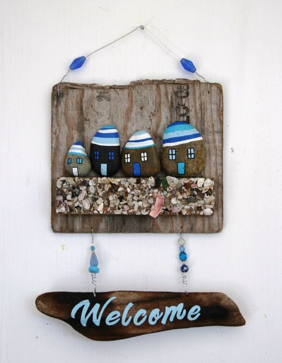 Driftwood Welcome Sign with rocks, shells, and beads