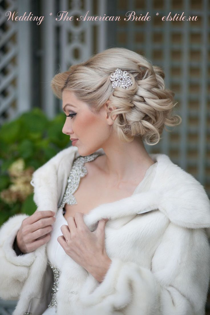 Wedding Hairstyle with curl ed updo, snowflake diamonte hair clip & neutral make-up - finished with a winter fur coat