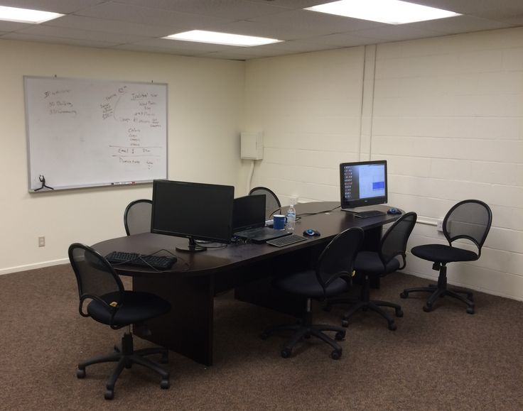 We Use A Classroom, Open Workroom, Style Setting For Programming And  Collaboration. No