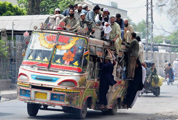 Pakistanis sit on a passenger bus during the transport strike in Peshawar on April 10, 2012, against  raised petrol prices.