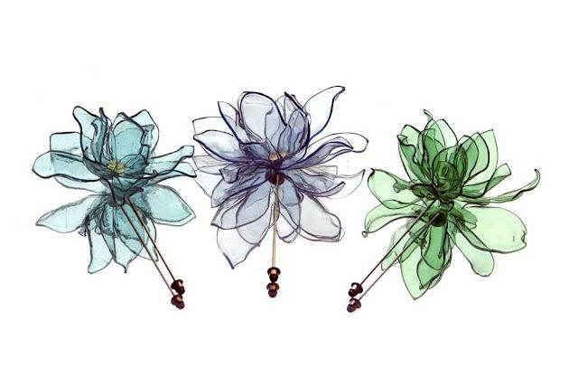 Flower pin brooches made from recycled plastic bottles